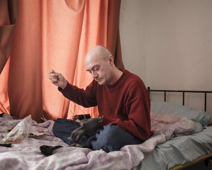 Homeless man in a reintagration shelter