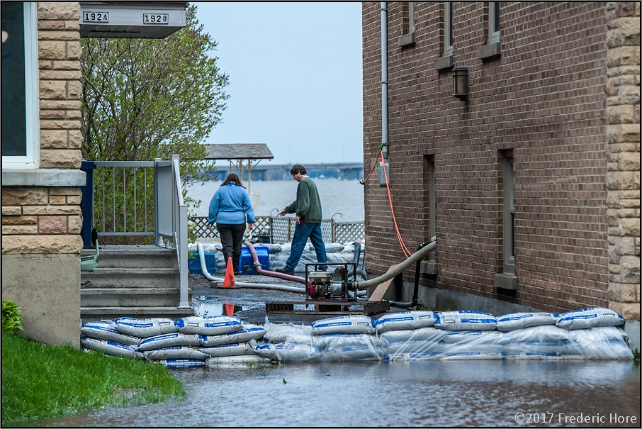 Pumping out after heavy floods hit Montreal