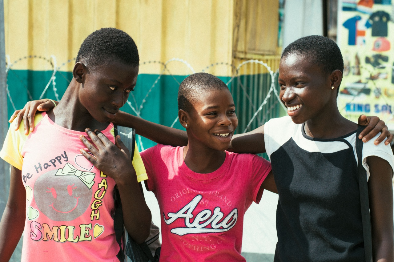 Three Friends on the Streets of Koforidua, Ghana.