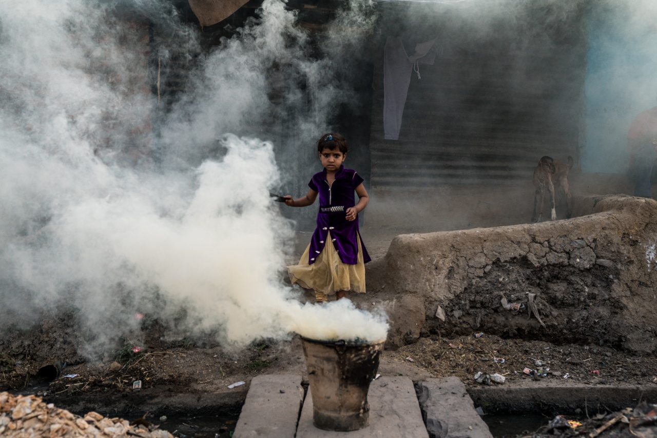 GIrl emerges from smoke.