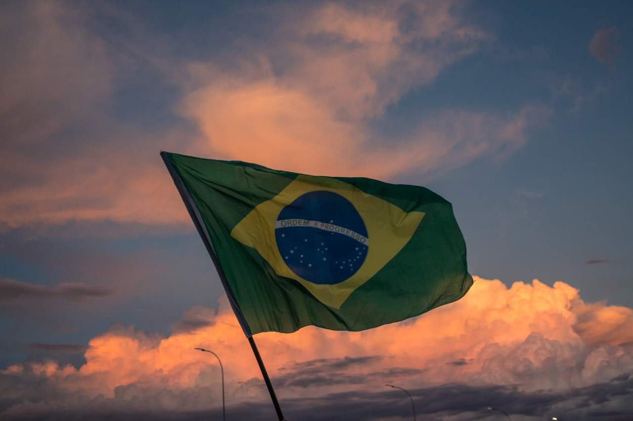Brazilian Flag over red sky