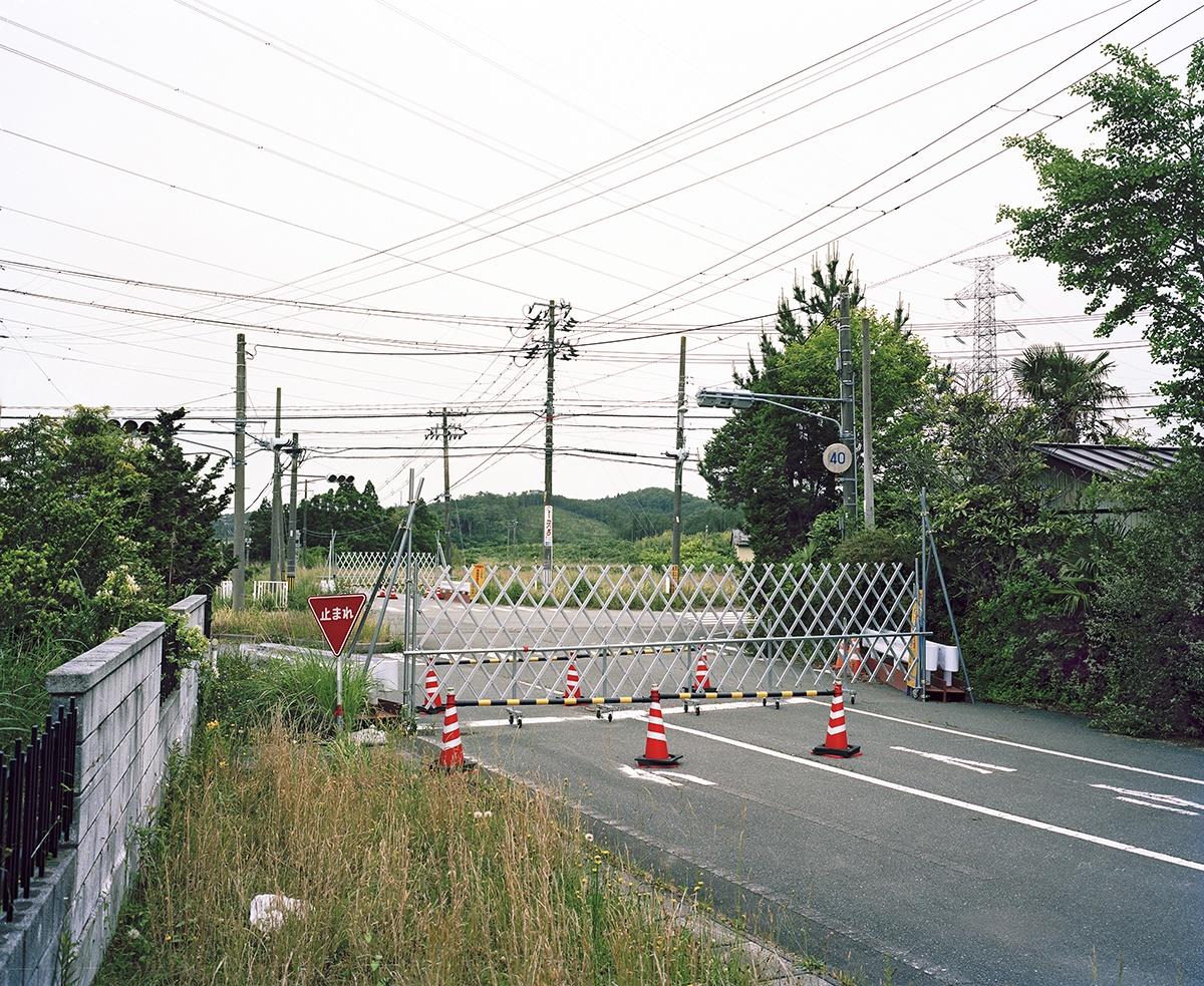 Gate. Fukushima Exclusion Zone near Namie. 2014.