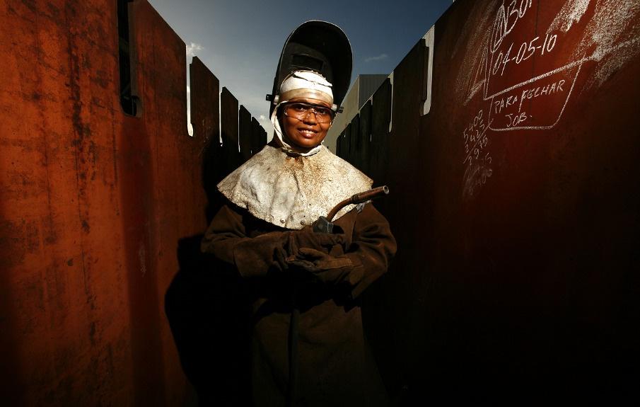 Woman welder at shipyard