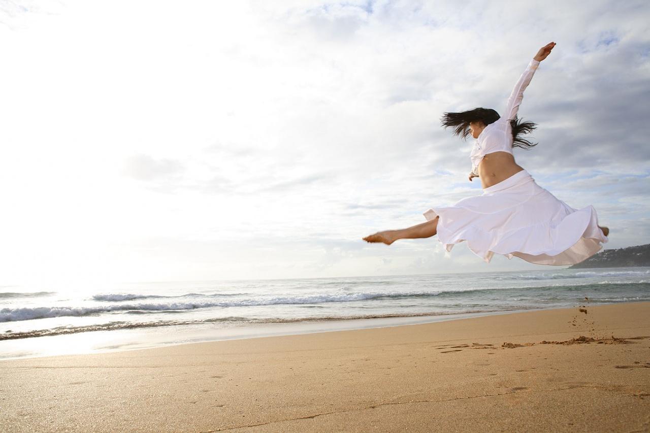 Jumping dancer on a beach