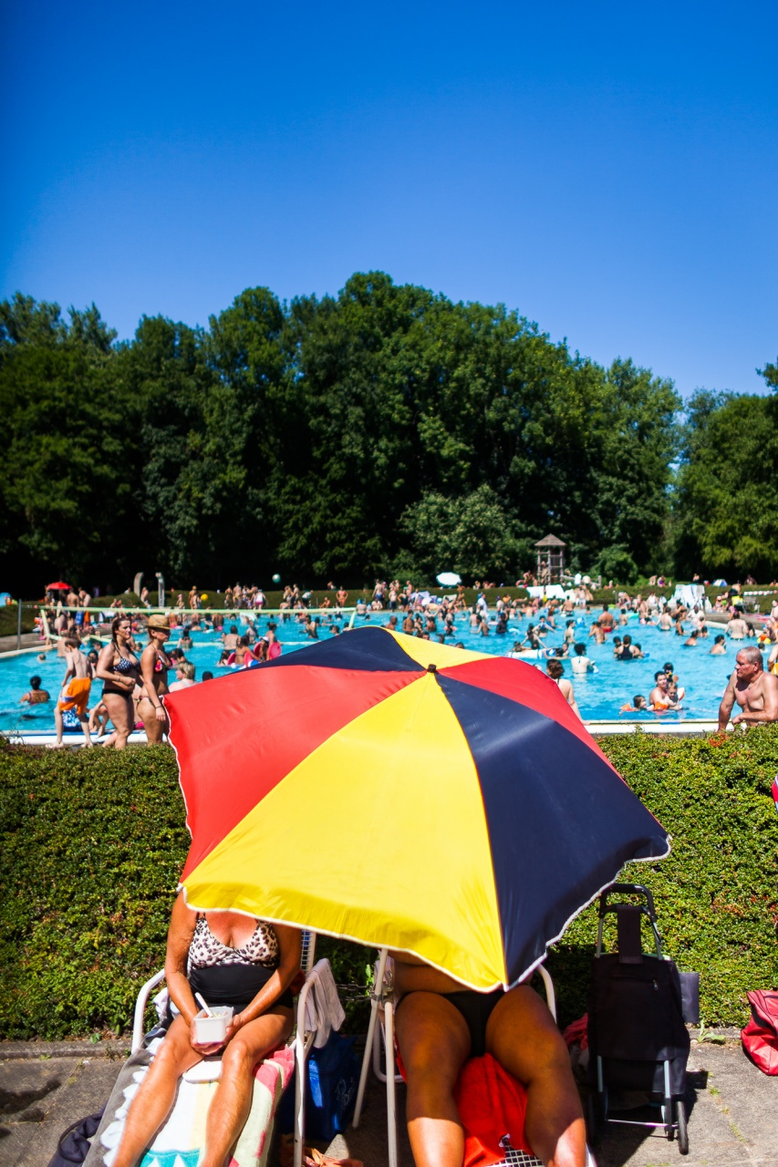 Sun bathing at the Public Pool, Germany, 2015