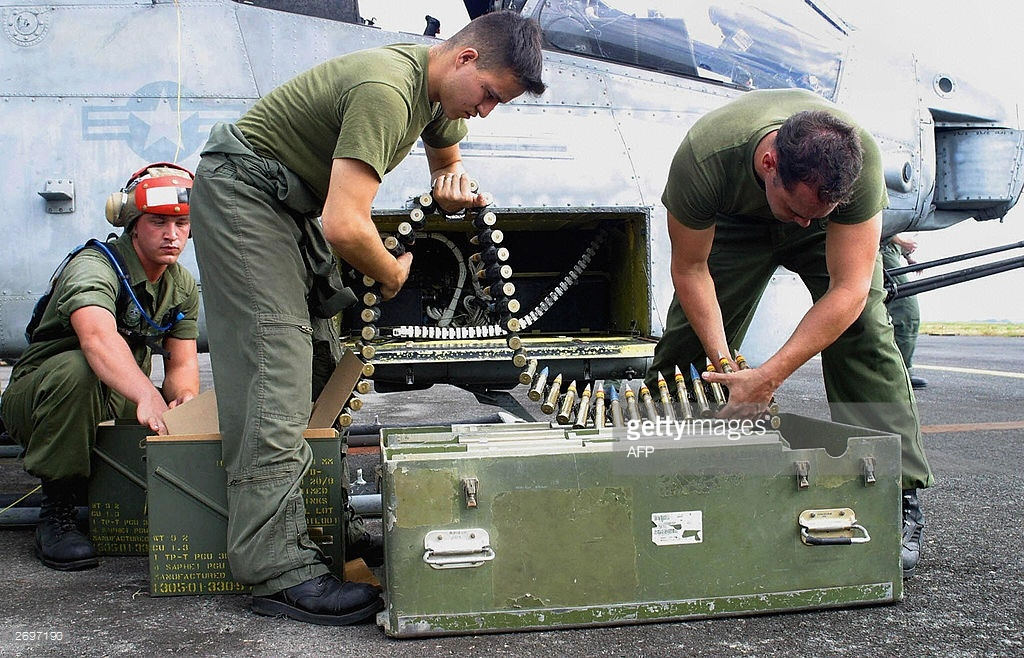 US Marines loads ammo onto an AH-1W 'Super Cobra'