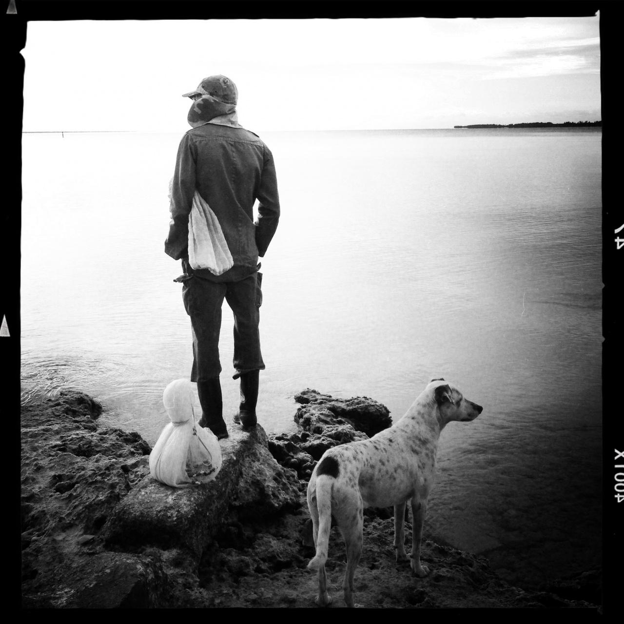 Fisherman and his dog