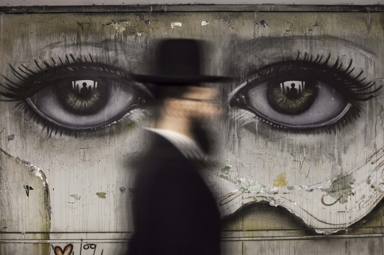 Hassidic Jewish Man passes a graffiti in Jerusalem