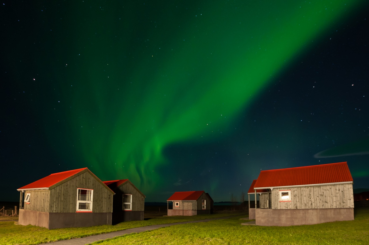 Northern Lights over Cabins in Iceland