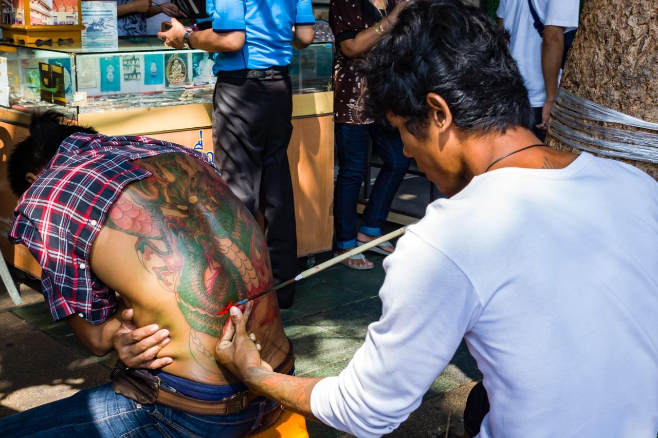 Bamboo Tattooing of a dragon, Bangkok.