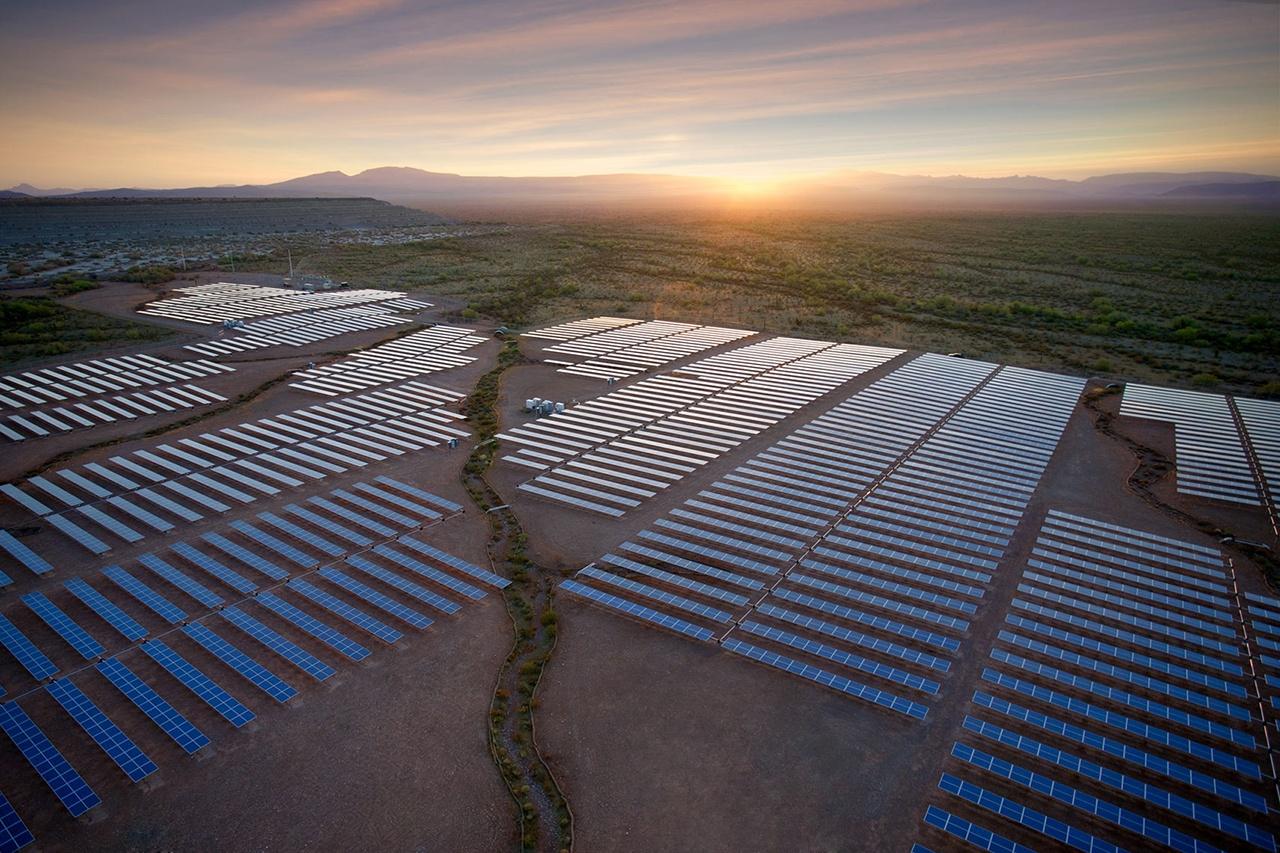Aerial of solar installation at sunrise