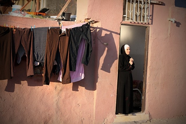 Palestinian woman watches protesters