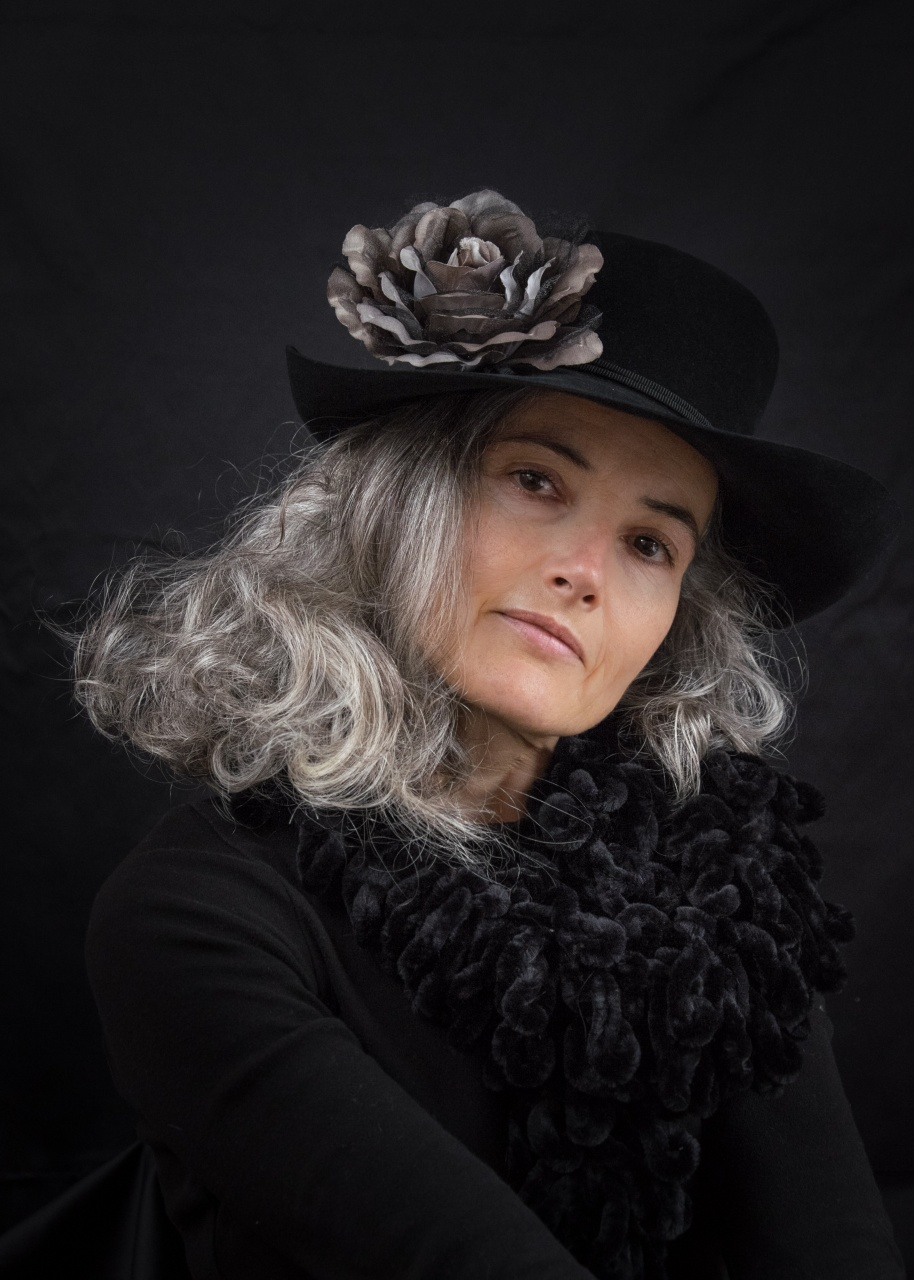 With a flower in her black hat