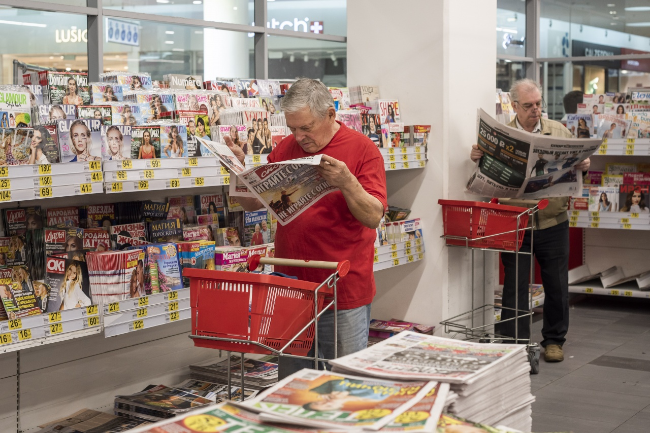 Reading newspapers in a russian supermarket.