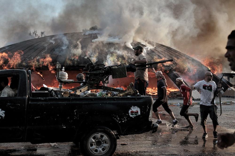 Libyan rebels storm Qaddafi's compound in Tripoli.