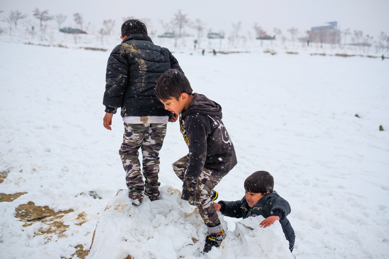 Boys playing in the snow.