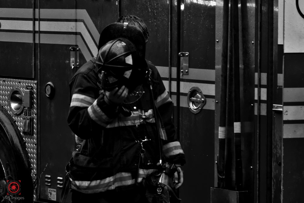 Fireman removing helmet