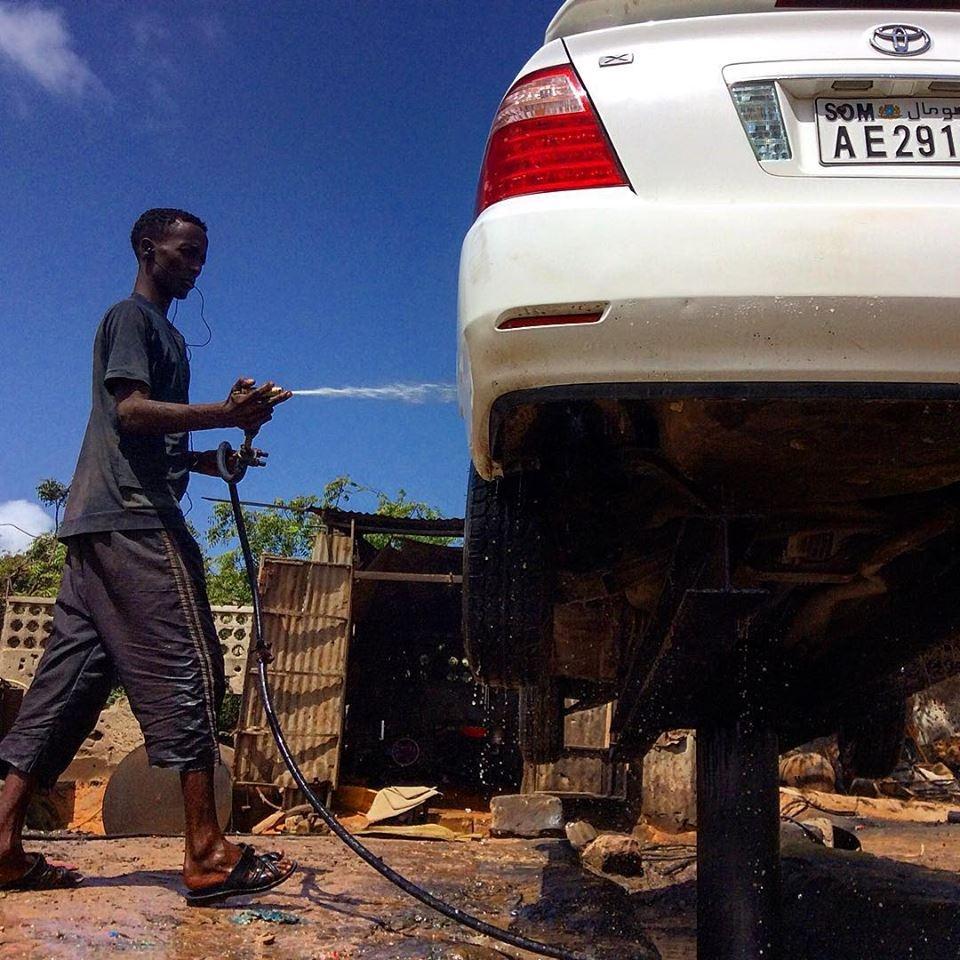 Car washer, Mogadishu, Somalia