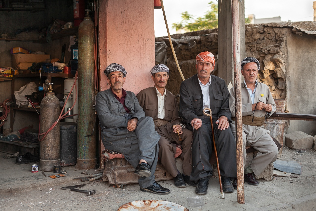 Kurdish Men Atop Engine