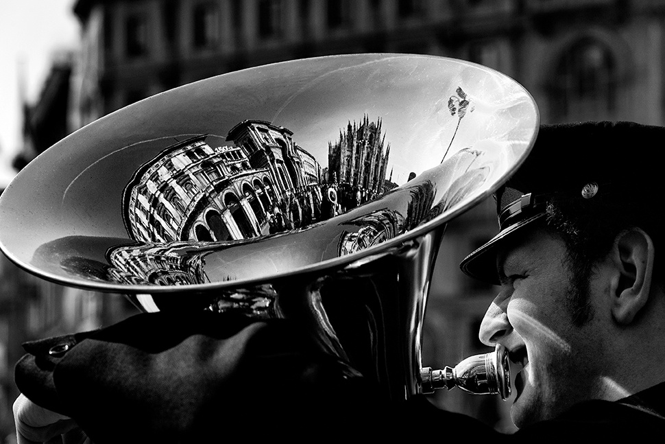 Milan reflected in a tuba